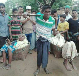 Rohingya man carrying parents in basket Sept 12 2017