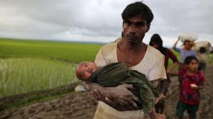 Rohingya man with baby Sept 12 2017