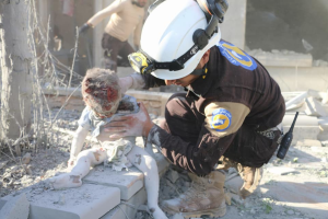White Helmet with injured child Sept 26 2017