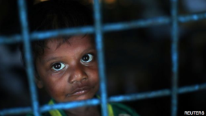 A young Rohingya boy at a Bangladesh primary school turned shelter
