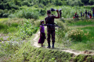 Bangladesh border guard & little girl (- Mohammad Ponir Hossain:Reuters) Oct 5 2017