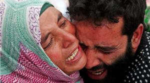Grieving Kashmiri couple (Danish Ismail:Reuters) Oct 27 2017