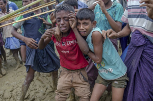 Ro boys being beaten back with stick from food (AP Photo:Dar Yasin) Oct 2 2017