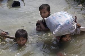 Ro family in river (Bernat Armangue:AP)