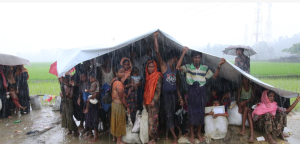 Ro refugees in rain (Guardian) Oct 6 2017