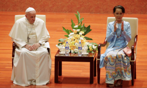 Aung San Suu Kyi applauds as she sits next to Pope Francis. Photograph- Max Rossi:Reuters