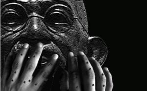 Gandhi with child's pellet hands (Masood Hussain)