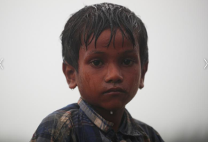Nur Kabir, 5, in rain waiting to cross to Bangladesh (Hannah McKay:Reuters) Nov 5 2017