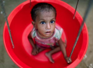 Ro  girl is weighed at the emergency nutrition treatment center in Balukhali refugee camp near Cox's Bazar, Bangladesh. REUTERS:Navesh Chitrakar