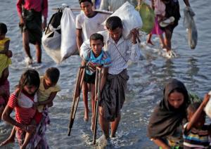 Ro refugee on crutches (Adnan Abidi:Reuters) Nov 7 2017