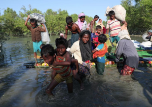 Ro refugees coming off improvised raft (REUTERS:Mohammad Ponir Hossain) Nov 11 2017