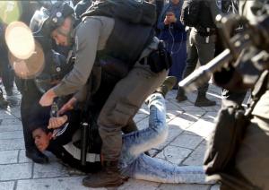 Israeli brutalizing teen in East Jerusalem (REUTERS:Ronen Zvulun) Dec 10 2017