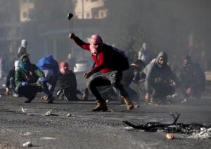 Pal protesters near Ramallah (REUTERS:Mohamad Torokman ) Dec 10 2017
