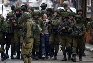 Palestinian boy & 20 IOF soldiers in Hebron (Wissam Hashiamoun) Dec 8 2017
