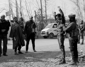 Indian soldier frisking man in Sopore, Baramulla district Jan 24 2018
