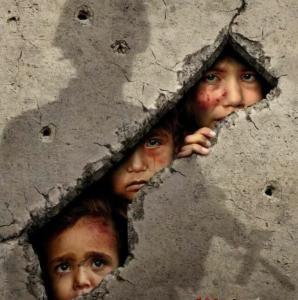 Children peeking through bomb holes Feb 2018