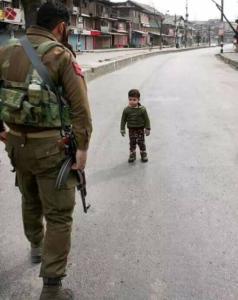 Kashmiri boy with Indian soldier Feb 2018