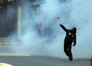 Srinagar protester Jan 19 returning tear gas canister (Faisal Khan) Feb 1 2018