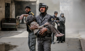 White Helmet rescue worker with child in Eastern Ghouta (Abdulmonam Eassa:AFP:Getty Images) Feb 21 2018