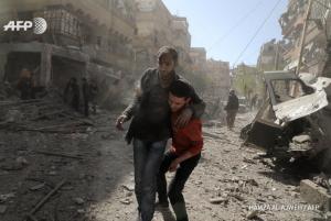 Civilians run following Syrian air strike on E. Ghouta Mar 20 (Hamza Al-Ajweh:AFP) Mar 20 2018