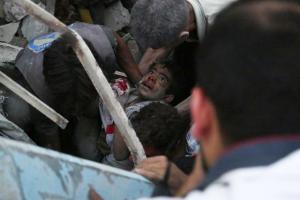 Douma boy being rescued June 16, 2015. (AFP : Sameer Al-doumy)