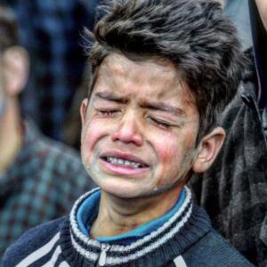 Grieving Kashmiri boy (Mar 9 2017 & 2018
