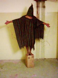 Hooded man at Abu Ghraib