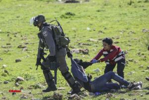 Palestinian first aid volunteer, a IOF soldier & a Pal. boy (Shehab News) Mar 13 2018