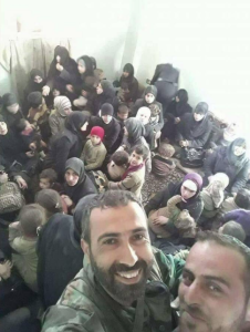 Syrian soldiers taking selfies with terrified women Mar 24 2018
