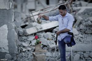 Gaza man watering plant (Muhammad Smiry) Apr 19 2018