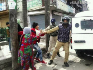 A Kashmiri mother trying to prevent her young son from getting arrested (Photog name in upper right corner) May 26 2018