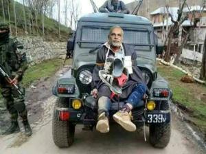 Modi on jeep as human shield