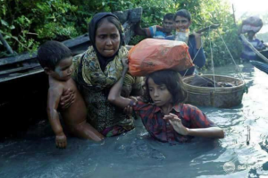 Rohingya mother and children crossing into Bangladesh Oct 16 2017 (Jorge Silva:Reuters)  May 14 2018
