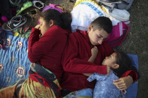 Siblings from El Salvador huddle together on a soccer field on Wednesday.Felix Marquez  Apr 30 2018