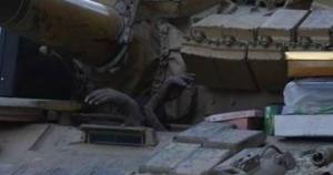 hands rising from Syrian tank May 30 2018