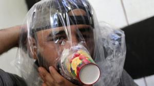 Idlib civilian in improvised gas mask (Khalil Ashawi:Reuters) Sept 11 2018