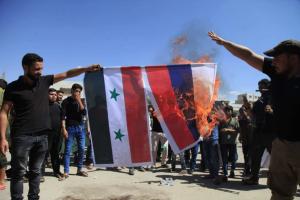 Idlib civilians burning Syrian & Russian flags Sept 7 2018 (Asaad Hanna on Twitter) Sept 7 2018