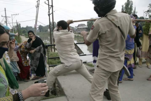 Indian troops beating family of Mudasir Ahmad Bhat at his funeral July 23 2018
